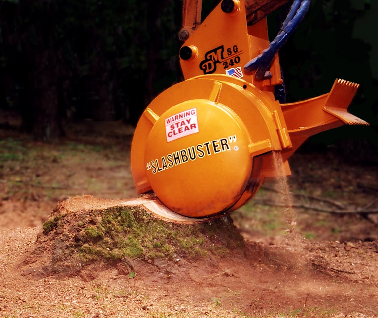 "An orange stump grinder with ""slashbuster"" printed on it grinding a stump"